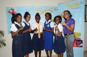 Thumps-Up for Curves: LASCO presents six bright young ladies a total of $300,000 in the second LASCO Curves GSAT Scholarship Awards for their excellent performance in this year's GSAT examinations. The recipients; (L-R) Keandra Leslie, Tenele Green,  Martina Young, Brianna Brown, Shellicia Bethune and Beyonce Black (absent) received their scholarship awards from Renee Rose (right) LASCO Distributorss Ltd. Brand Manager at LASCO, White Marl on Wednesday, July 29. The LASCO Curves GSAT Scholarships were presented to six
