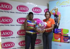 Doreen Walters (Left) is one of the winners of the Win Your Wings promotion. She is presented a gift basket by LASCO Brand Manager Renee Rose.