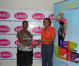 Beverley Jackson (Left) is one of our July winners in the Win Your Wings with Curves promotion. She is presented a cheque worth $20,000 from LASCO Brand Manager, Renee Rose.