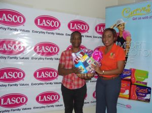 Renee Rose, Brand Manager at LASCO presents Win Your Wings with Curves winner Faithlyn Collins (Left) with a gift basket.