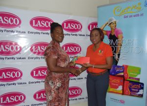 Kimarley Roberts (Left) is receives a trip to Adam & Eve Spa from Renee Rose, Brand Manager at LASCO Distributors.