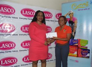 Sherika Gordon (Left) receives a cheque of $20,000 by Renee Rose, Brand Manager at LASCO Distributors.