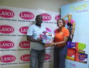 Brand Manager at LASCO, Renee Rose (Right) presents Wayne Spence a gift basket for winner Kimberly Atkinson.