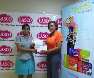 Sandra Morgan (Left), is presented with both the first prize of a weekend for 2, and also a cash prize of $20,000 by LASCO Brand Manager, Renee Rose.